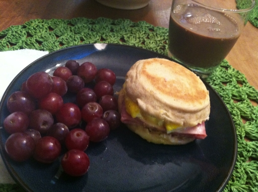 Breakfast sandwich and grapes