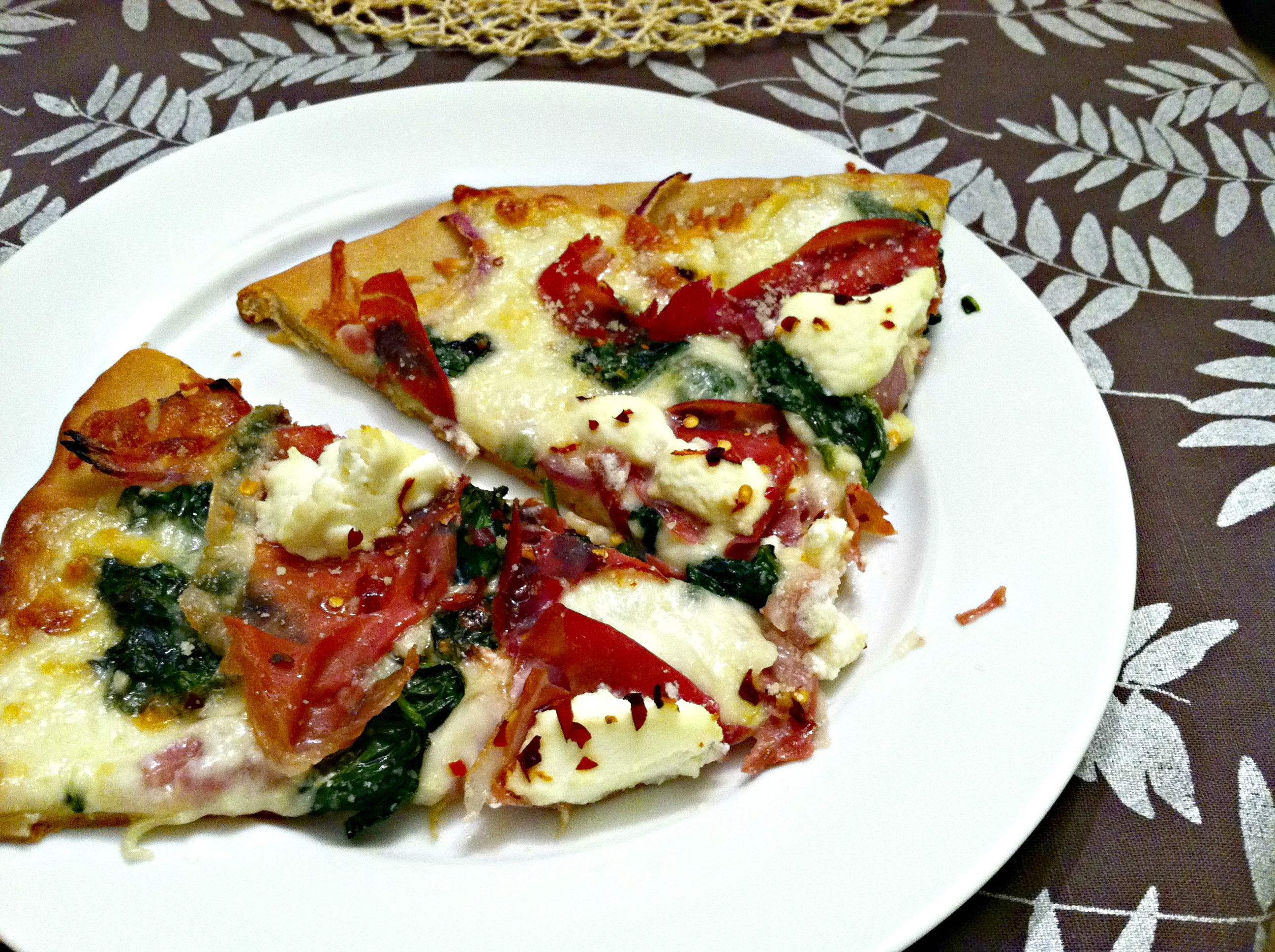 ... pizza dough and topped it with sauteed spinach, prosciutto, ricotta